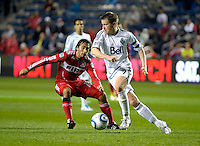 Vancouver midfielder Terry Dunfield (7) dribbles away from Chicago midfielder Gaston Puerari (18).  The Chicago Fire tied the Vancouver Whitecaps 0-0 at Toyota Park in Bridgeview, IL on May 7, 2011.