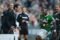 FUSSBALL   1. BUNDESLIGA   SAISON 2013/2014   7. SPIELTAG SV Werder Bremen - 1. FC Nuernberg                    29.09.2013 Manager Thomas Eichin (li) und Eljero Elia (re, beide SV Werder Bremen) jubeln nach dem 3:2