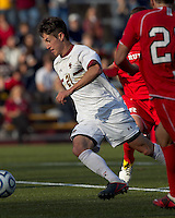 Boston College midfielder/defender Colin Murphy (21) on the attack.  Rutgers University defeated Boston College in penalty kicks after two overtime periods in NCAA Division I tournament action, at Newton Campus Field, November 20, 2011.