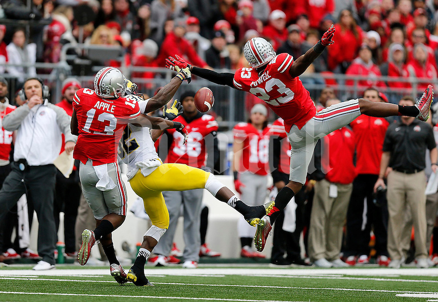Ohio State Buckeyes safety Tyvis Powell (23) breaks up a pass intended for Michigan Wolverines wide receiver Amara Darboh (82) as Ohio State Buckeyes cornerback Eli Apple (13) helps during the third quarter of the NCAA football game against Michigan at Ohio Stadium on Saturday, November 29, 2014. (Columbus Dispatch photo by Jonathan Quilter)
