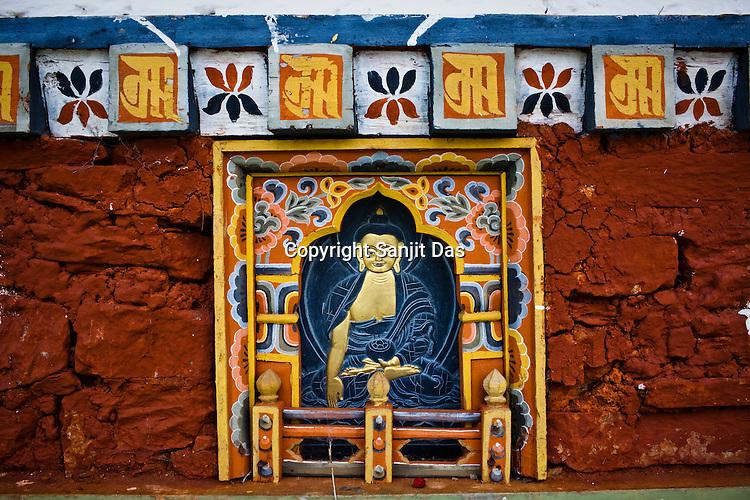 An engraved Buddha is seen on one of the 108 stupas at the Dochu La (mountain pass) on the way to Punakha, Bhutan. Photo: Sanjit Das/Panos