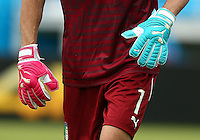 The odd coloured pink and blue Puma goalkeeping gloves of Italy goalkeeper Gianluigi Buffon