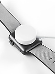 Apple Watch smartwatch charging wirelessly by inductive wireless charger