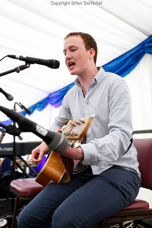 A family member plays guitar and sings in the tent during the Caulfield family reunion at the Caulfield home in Granlahan, County Roscommon, Ireland on Tuesday, June 25th 2013. (Photo by Brian Garfinkel)