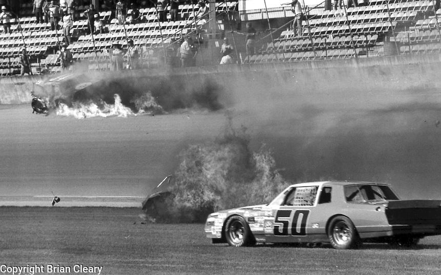 Natz Peters 60 Jim Hurlbert fiery crash accident in consolation race before Daytona 500 at Daytona International Speedway in Daytona Beach, FL on February  1984. (Photo by Brian Cleary/www.bcpix.com)