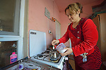 Ekhlas Jomaa, a Yazidi woman displaced from Bashiqa by the Islamic State group in 2014, prepares tea in their temporary home in Dohuk, Iraq. Her husband participates in a skills training program sponsored by the Christian Aid Program Nohadra - Iraq (CAPNI).