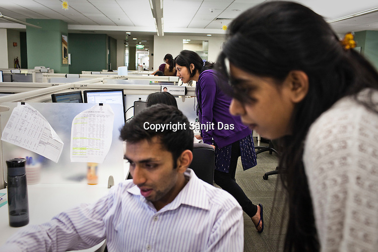 Ernst & Young employees are seen consulting at the Ernst & Young Global Shared Services office in Bangalore, Karnataka, India. Ernst & Young has 49% women working for them in the India office. Photo: Sanjit Das