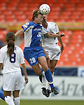 Abby Wambach (28) and Marci Miller (16) jump for the ball at RFK Stadium in Washington, DC on 4/26/03 during a game between the Atlanta Beat and Washington Freedom