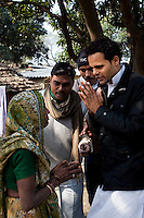 "Minister of Legislative Assembly, Ritesh Pandey, 30, campaigns door-to-door in a Dalit (the lowest Hindu caste) village with a crowd of supporters chanting slogans such as ""long live Ritesh Pandey"" and ""press the button, decide the elephant (symbol)"" in Ajanpara, Ambedkar Nagar, Uttar Pradesh, India, on 21st January, 2012. Returning 1.5 years ago after almost 10 years abroad, Pandey is contesting on behalf of the Bahujan Samaj Party (BSP), a party that is based on its appeal to Dalit voters. Party leader Mayawati, herself a Dalit, has recently been giving out more tickets to muslims and high caste candidates in an attempt to woo a larger spectrum of voters in Uttar Pradesh, a Bellwether state. Photo by Suzanne Lee for The National (online byline: Photo by Szu for The National)"
