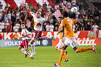 Joel Lindpere (20) of the New York Red Bulls heads the ball. The New York Red Bulls defeated the Houston Dynamo 2-0 during a Major League Soccer (MLS) match at Red Bull Arena in Harrison, NJ, on August 10, 2012.