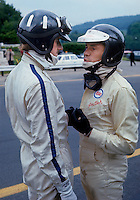 Formula One (Grand Prix) driversGraham Hill (twice world champion) and Jim Clark (twice world champion), drivers for Team Lotus (Spa-Francorchamps, 1967 or 1968).