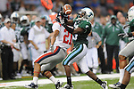 Tulane cornerback Phillip Davis (13)  intercepts a pass intended for Ole Miss wide receiver Lionel Breaux (21) at the Louisiana Superdome in New Orleans, La. on Saturday, September 11, 2010. The play was called back because of penalty. Ole Miss won 27-13.