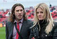 24 March 2012: Toronto FC midfielder Torsten Frings #22 walks with a lady friend during the warm-up in a game between the San Jose Earthquakes and Toronto FC at BMO Field in Toronto..The San Jose Earthquakes won 3-0..