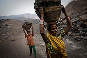 Young children and other villagers dig out coal from the open cast mines and carry them back to their village in Borapahari in Jharia, Jharkhand, India.  Photo: Sanjit Das