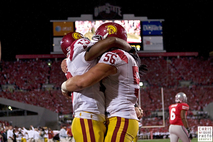 12 September 2009:  Football -- USC running back Stafon Johnson celebrates his game-winning touchdown with guard Alex Parsons against Ohio State at Ohio Stadium in Columbus.  USC won 18-15.  Photo by Christopher McGuire.
