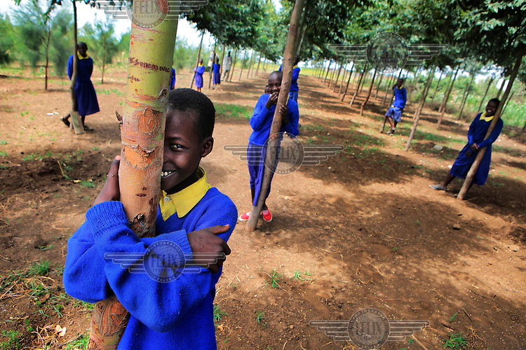 Student Benson Koonyo holds the eucalyptus tree he has been watering each day until it was big enough to grow on its own. Benson is 11 years old and a fourth class pupil in the Nturumeti Primary School near Narok. In 2009 the students planted 105 eucalyptus trees. The following year 300 casuarina and grevillea trees were planted and this year over 400 trees will be planted. The eucaluptus trees have already grown into big trees and will be harvested in three years in order to be sold as timber for furniture and construction. With the profit the school can buy vegetables in order to suport a healthy learning project which they launched in collaboration with the Belgian Flemish Association for Development Cooperation and Technical Assistance (VVOB).