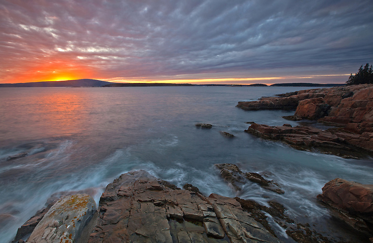 Sunset over Cadillac Mountain as seen from the coastline on the Schoodic Peninsula, Acadia National Park, Maine, USA