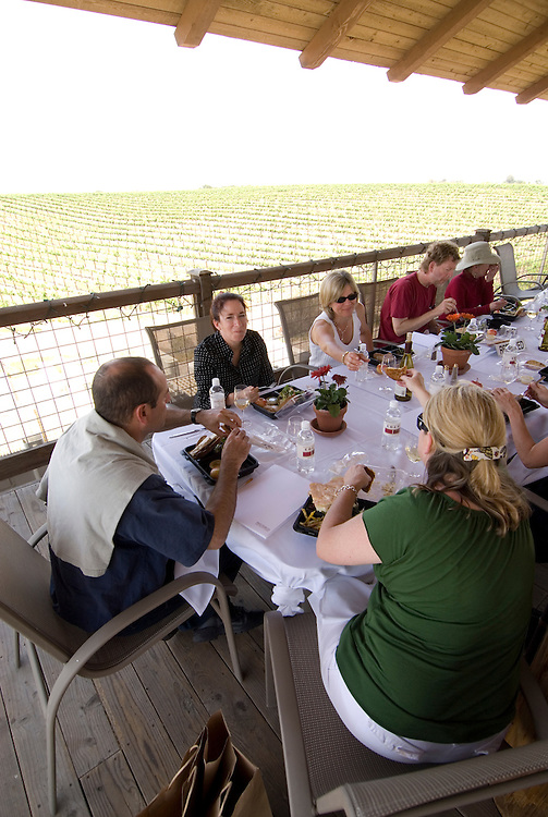 California, San Luis Obispo County: At Eberle Winery and vineyards in Paso Robles, noted for red wines.  Lunch on deck at winery with vineyards in background..Photo caluis137-71033..Photo copyright Lee Foster, www.fostertravel.com, 510-549-2202, lee@fostertravel.com