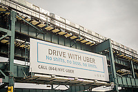 A sign advertising for drivers outside of Uber's Queens offices in New York on Monday, February 1, 2016. Uber drivers are upset over Uber's recent 15% cut in fares meaning less money for the drivers so they have gone on strike. Uber claims that the cut will increase volume and the drivers will have less down-time.   (© Richard B. Levine)