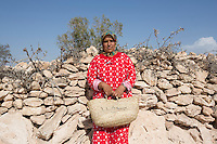 "Fatima Aamin, 36, from Idmine. A mother of two, Aamin has joined the cooperative in 2010 and has been able to gain around 60 euros per month since then. Although Aamin spends only half a day at Ajddigue, the woman feels empowered by having her own revenue. ""When I was producing oil at home, it was my husband who sold it at the market and kept all the money"" she explain. ""But now, thanks to this work, local women feel they can stand up to their husbands."""