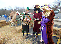 NWA Media/Michael Woods --12/21/2014-- w @NWAMICHAELW...The wise men (left to right) Dave Brashinger, Troy Strauss, and Eric McCalla, play their role as visitors walk through the living nativity at the Bella Vista Christian Church Sunday evening in Bella Vista.  It is the second year for the church to offer the live nativity to the community, with a new feature of  live camels for this years display.