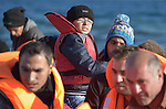 Refugees--including this boy--land on a beach near Molyvos, on the Greek island of Lesbos, on November 3, 2015, after crossing the Aegean Sea from Turkey. Local and international volunteers welcomed the arriving refugees with food and medical care and dry clothes before the newcomers proceeded on their way toward western Europe. Their boat to Greece was provided by Turkish traffickers to whom the refugees paid huge sums to arrive in Greece.