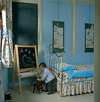 Jehanne's young son playing in his bedroom