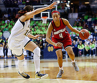 SOUTH BEND, IN - FEBRUARY 11: Natalie Achonwa #11 of the Notre Dame Fighting Irish guards as Antonita Slaughter #4 of the Louisville Cardinals dribbles the ball at Purcel Pavilion on February 11, 2013 in South Bend, Indiana. Notre Dame defeated Louisville 93-64. (Photo by Michael Hickey/Getty Images) *** Local Caption *** Natalie Achonwa; Antonita Slaughter