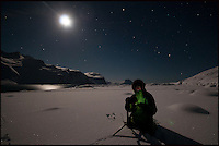 BNPS.co.uk (01202 558833).Pic: AlistairWilson/BNPS..***Please Use Full Byline***..Samantha Crimmin at work in sub zero temperatures on the Harker Glacier in South Georgia...A British Doctors braved freezing conditions to capture unique pictures of the night sky from the tiny British island of South Georgia in the remote South Atlantic...Amateur photographer Samantha Crimmin's stunning photos of the sky at night over South Georgia have left locals so star-struck they have been turned into stamps...Dr Samantha Crimmin was working as an emergency medic for the British Antartic Survey team when she took the celestial images in her spare time...Dr Crimmin used long exposures and plenty of patience to create the incredible shots that show star trails in a perfect circular motion...Her gallery of photos depict the night sky above different locations on the tiny outpost in the south Atlantic...They include one above the Harker Glacier - named after British geologist Alfred Harker - and over the wrecks of two Norwegian whaling ships at Grytviken.