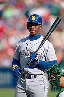 OAKLAND, CA - Ken Griffey Jr. of the Seattle Mariners bats during a game against the Oakland Athletics at the Oakland Coliseum in Oakland, California in 1990. Photo by Brad Mangin