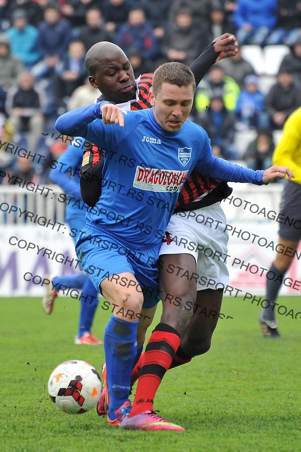 Fudbal Super liga season 2013-2014<br /> Novi Pazar v Sloboda Point<br /> Ivan Obrovac (#8) FK Novi Pazar u duelu sa Sasa Peci (#4) FK Sloboda Point<br /> Novi Pazar, 8. 3. 2014.<br /> foto: Emir Sadovic/Starsportphoto &copy;