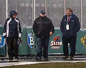 Joe Bertagna checks out the ice during the rain delay. - The University of Maine Black Bears defeated the Boston University Terriers 7-3 (2EN) on Saturday, January 11, 2014, at Fenway Park in Boston, Massachusetts.