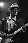 Ray Phiri, Graceland Tour, Berkeley Community Theater, Feb. 27, 1987, 90-25-24.  African jazz, fusion and mbaqanga musician born in Mpumalanga. He became founding member of the Cannibals in the 1970's. When the Cannibals disbanded Ray founded Stimela, with whom he conceived gold and platinum-selling albums like Fire, Passion and Ecstacy (1991), Look, Listen and Decide (1992) as well as the controversial People Don&rsquo;t Talk So Let&rsquo;s Talk.<br /> <br /> In 1985 Paul Simon asked Ray along with Ladysmith Black Mambazo to join his Graceland project, which was successful but also helped the South Africans to make names for themselves abroad. Ray was to collaborate with Paul Simon again on Simon&rsquo;s Rhythm of the Saints album, which saw him perform on stages such as Central Park and Madison Square Garden as well as appearing on top television shows in the USA.