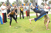 Members of Capoeira Los Angeles demonstrate their art at Santa Monica's Muscle Beach on Sunday,  May 13, 2012. Capoeira is a Brazilian blend of martial art, game, and dance originated in Brazil in the 16th Century, from the regions known as Bahia, Pernambuco, Rio de Janeiro, Minas Gerais and Sao Paulo.