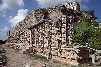 """Western façade of the Codz Poop (""""Rolled-up matting"""" in Maya), originally covered with 250 stone masks of Chaac, the big-nosed god of rain, Puuc Architecture, 700-900 AD, Kabah, Yucatan, Mexico. Picture by Manuel Cohen"""