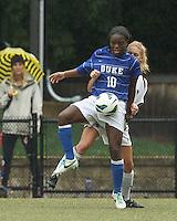 Duke University midfielder Toni Payne (10) controls the ball as Boston College midfielder Lauren Bernard (5) pressures.Boston College (white) defeated Duke University (blue/white), 4-1, at Newton Campus Field, on October 6, 2013.