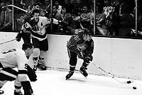 Seals vs Kings hockey: Seals Doug Roberts and Bob Dillabough, Kings Matt Ravlich. (1969 photo/by Ron Riesterer)
