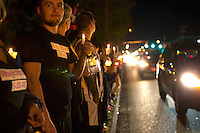BURLINGTON, WA - SEPTEMBER 26: Hundreds came out for a candlelight vigil along Burlington Boulevard on September 26, 2016 in Burlington, Washington. Five people were killed by a gunman several nights ago at the Cascade Mall. One of those killed was a classmate of theirs at school. The suspect, Arcan Cetin, 20, a resident of Oak Harbor, Washington, was arraigned today. (Photo by Karen Ducey/Getty Images)