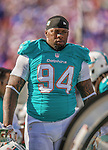 14 September 2014: Miami Dolphins defensive tackle Randy Starks stands on the sidelines during a game against the Buffalo Bills at Ralph Wilson Stadium in Orchard Park, NY. The Bills defeated the Dolphins 29-10 to win their home opener and start the season with a 2-0 record. Mandatory Credit: Ed Wolfstein Photo *** RAW (NEF) Image File Available ***