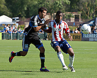 Santa Clara, California - Sunday May 13th, 2012: Michael Lahoud of Chivas USA defending Steven Beitashour of San Jose Earthquakes during a Major League Soccer match at Buck Shaw Stadium