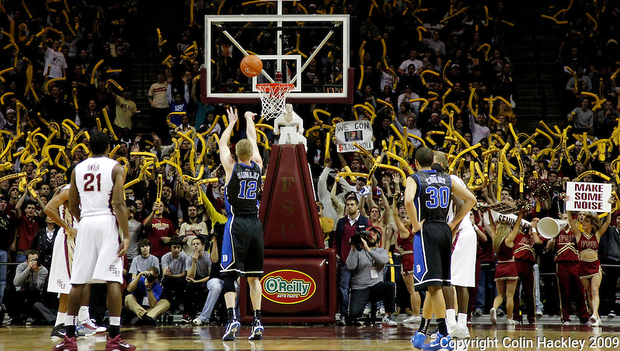 TALLAHASSEE, FL 1/12/10-FSU-DUKE MBB11 CH-Florida State fans try to distract Duke's Kyle Singler during  a first half free throw Wednesday at the Donald L. Tucker Center in Tallahassee...COLIN HACKLEY PHOTO