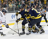 Paul Thompson (UNH - 17), Karl Stollery (Merrimack - 7), John Heffernan (Merrimack - 8) - The Merrimack College Warriors defeated the University of New Hampshire Wildcats 4-1 (EN) in their Hockey East Semi-Final on Friday, March 18, 2011, at TD Garden in Boston, Massachusetts.