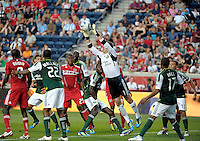 Portland goalkeeper Troy Perkins (1) catches the ball in traffic.  The Portland Timbers defeated the Chicago Fire 1-0 at Toyota Park in Bridgeview, IL on July 16, 2011.