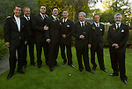 Groomsmen and fathers enjoy the antics of the women being photographed as they await their turn.