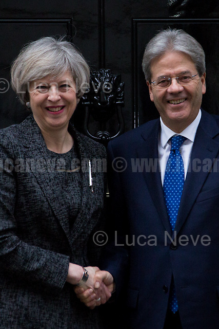 """London, 09/02/2017. Today, The Italian Prime Minister, Paolo Gentiloni, visited 10 Downing Street where he had a meeting with the British Prime Minister Theresa May. Noticeably, the Italian Prime Minister used - again (His predecessor and leader of the PD - Democratic Party - Matteo Renzi started this """"tradition"""" to visit 10 Downing Street with a non-Italian car in 2014 replacing the official Maserati Quattroporte - number plate """"Ita 1"""" - with a Chrysler 300c made by FCA, Fiat Chrysler Automobiles. FIAT - Aka Fabbrica Italiana Automobili Torino - moved its tax domicile from Italy to the UK just the day before - see my story here https://goo.gl/hH5a6O) - a different car for his official visit in the UK. In fact, this time the official Maserati Quattroporte """"Ita 1"""", was replaced by an Audi A8L 6.3 W12 quattro, a luxury car produced by the German and world leader of the car industry, Volkswagen Group."""