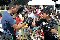 Santa Monica Police Activity League Boxing Coach Jose Perez (left) and his student Angel Vasquez, 14,  give a demonstration during the City of Santa Monica's  Back To School Safety Fair at Virginia Avenue Park on Tuesday, August 23, 2011. The Fair included safety tips from police oficers like what to be aware of when walking to and from school. Kids who attended the event  received free school supplies.