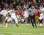 Ole Miss running back Jeff Scott (3) vs. Mississippi State defensive back Jay Hughes (30) at Vaught-Hemingway Stadium in Oxford, Miss. on Saturday, November 24, 2012. Ole Miss won 41-24.