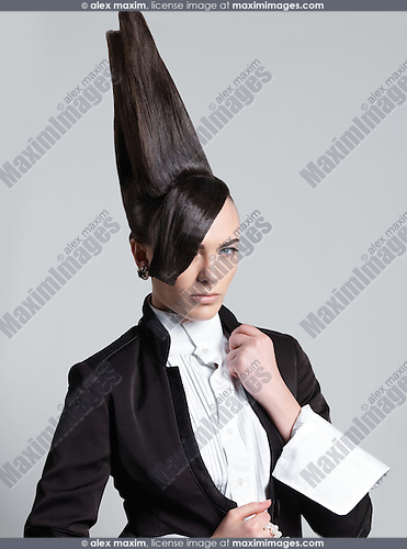Stock photo: Artistic portrait of a woman with a creative tall ...