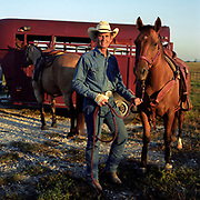 Cowboy Church. Texas, USA. 2007. Pastor Ron attending his horse before the roping night held at the Cowboy Church. Ron is the head preacher at the 1,000 Hills Cowboy Church.