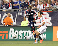 Vancouver Whitecaps FC defender Young-Pyo Lee (12) passes the ball as New England Revolution forward Saer Sene (39) closes. In a Major League Soccer (MLS) match, the New England Revolution defeated Vancouver Whitecaps FC, 4-1, at Gillette Stadium on May 12, 2012.